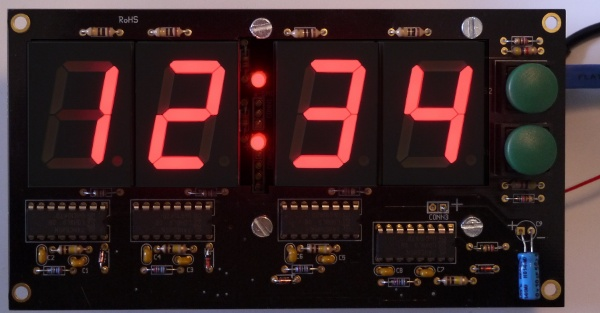 [large 4-digit LED display, in use]