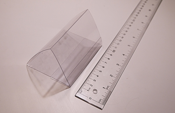[clear plastic packaging folded into triangle shape]