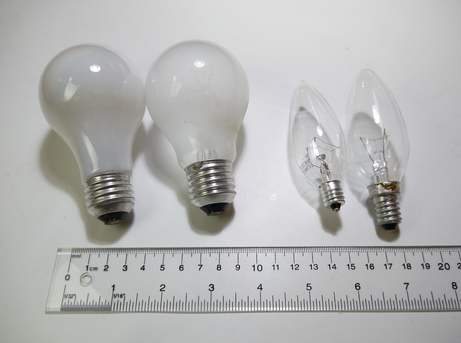 four of the most common light bulbs us a19 with e26 european e27 us b10 with e12 european e14